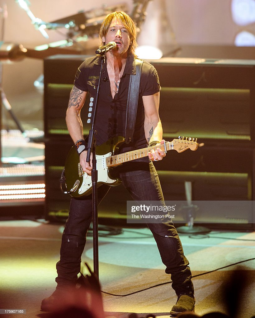 COLUMBIA, MD - August 8th, 2013 - Keith Urban performs at Merriweather Post Pavilion as part of his Light The Fuse Tour. Urban's eighth studio album, Fuse, will be released in September.