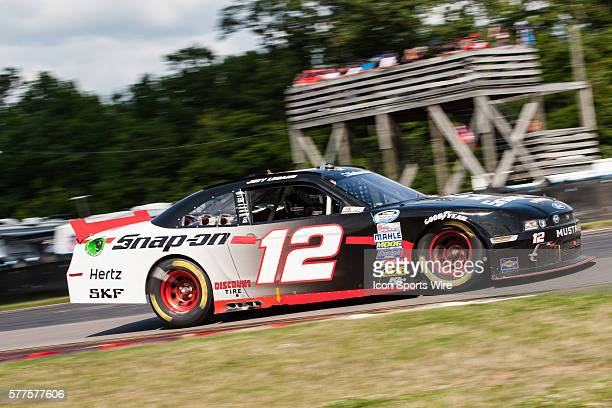 NASCAR Nationwide Series driver Joey Logano driver of the SnapOn Ford exits the bus stop during the NASCAR Nationwide Series Zippo 200 at Watkins...
