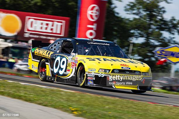 NASCAR Nationwide Series driver Marcos Ambrose driver of the Stanley Ford exits the bus stop during the NASCAR Nationwide Series Zippo 200 at Watkins...