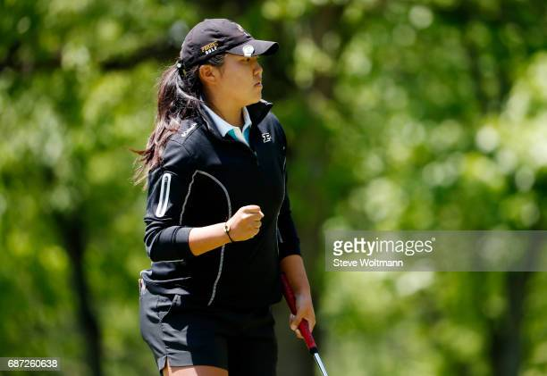 August Kim of Purdue celebrates a birdie putt during the Division I Women's Golf Individual Championship held at Rich Harvest Farms on May 22 2017 in...