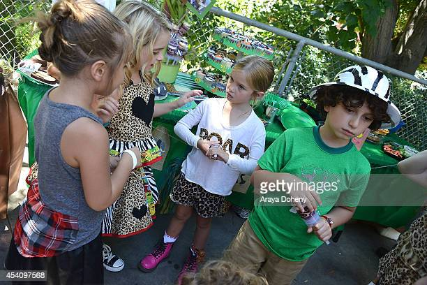 August Maturo attends his 7th birthday celebration at Los Angeles Zoo on August 24 2014 in Los Angeles California