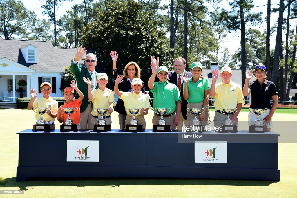 Augusta National Golf Club Chairman Billy Payne, USGA President Diana Murphy and PGA President Paul Levy pose for a photo with the overall winners pose after the Drive, Chip and Putt Championship at Augusta National Golf Club on April 2, 2017 in Augusta, Georgia.