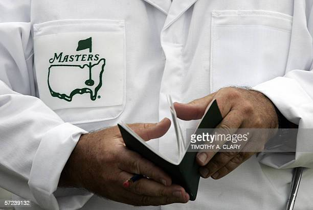 A caddie looks over his yardage book before the start of his first practice round 03 April 2006 at the Augusta National Golf Club the site of the...