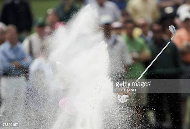 Tiger Woods of the US hits out of the sand trap on the second green at Augusta National Golf Club 05 April 2007 during the first round of the 71st...