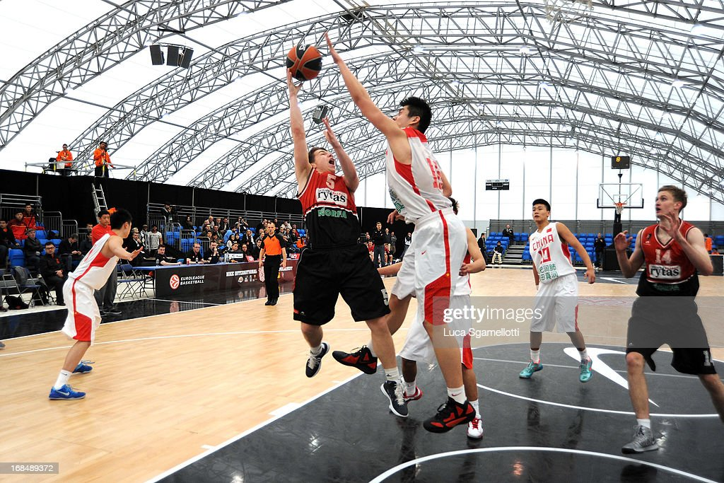 Augustas Suliuskas, #5 of Lietuvos Rytas Vilnius competes with Kai Jiang, #13 of Team China during the Nike International Junior Tournament game between Lietuvos Rytas Vilnius v Team China at London Soccerdome on May 10, 2013 in London, United Kingdom.
