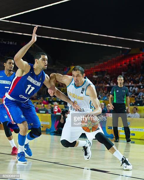 Sergiy Viktorovich Gladyr and Eloy Antonio Camacho Vargas in the match of the group stage of world basketball Espana 2014 between Ukraine and the...