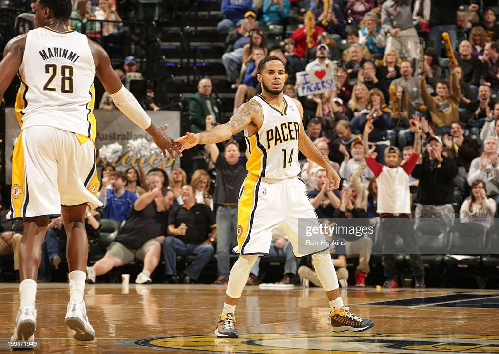 D.J. Augustin #14 and Ian Mahinmi #28 of the Indiana Pacers congratulate each other during the game between the Indiana Pacers and the Charlotte Bobcats on January 12, 2013 at Bankers Life Fieldhouse in Indianapolis, Indiana.