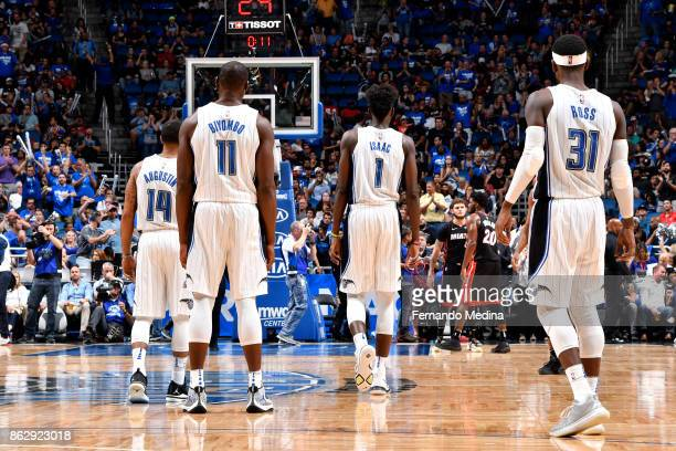 J Augustin Bismack Biyombo Jonathan Isaac and Terrence Ross of the Orlando Magic look on during the game against the Miami Heat on October 18 2017 at...