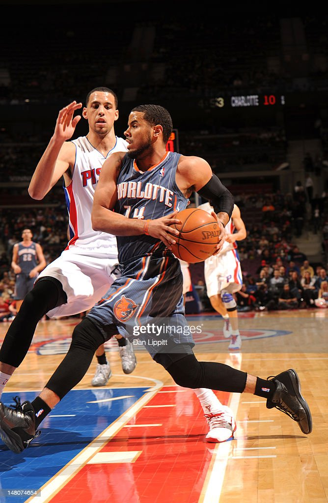 D.J. Augustin drives to the basket against the Detroit Pistons during the game on March 31, 2012 at The Palace of Auburn Hills in Auburn Hills, Michigan.