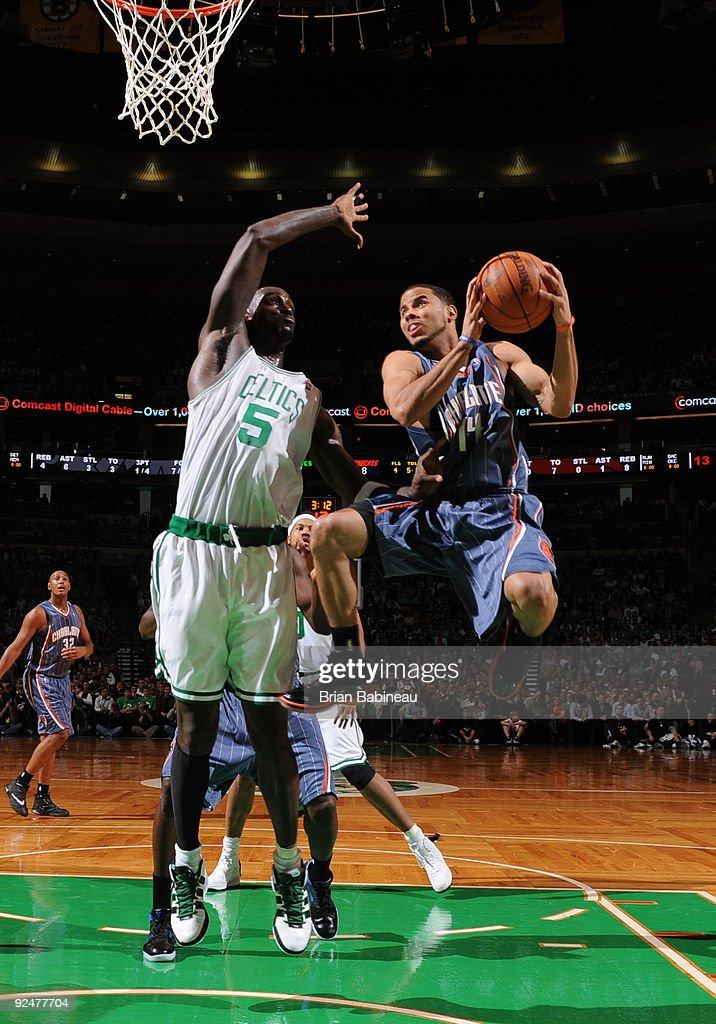 J Augustin of the Charlotte Bobcats drives the lane against Kevin Garnett of the Boston Celtics on October 28 2009 at the TD Garden in Boston...