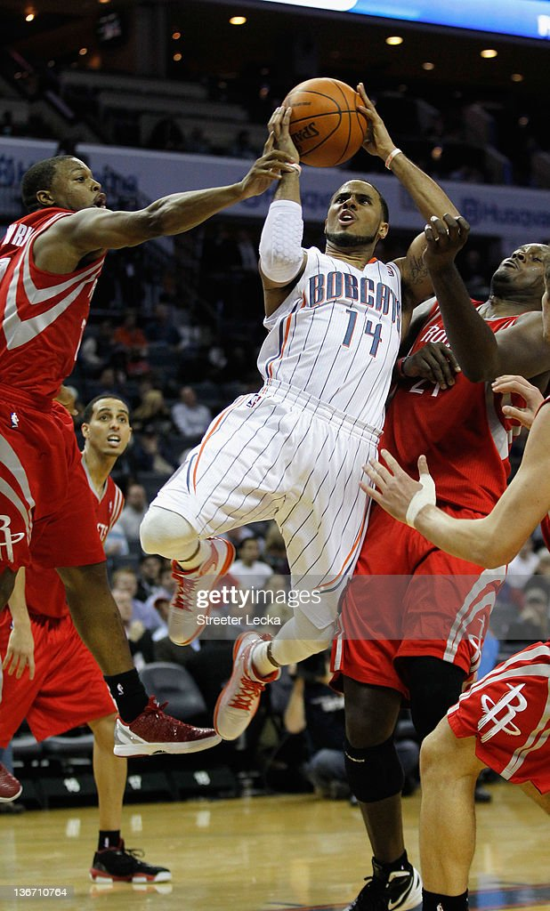 D.J. Augustin #14 of the Charlotte Bobcats drives to the basket against the Houston Rockets during their game at Time Warner Cable Arena on January 10, 2012 in Charlotte, North Carolina.