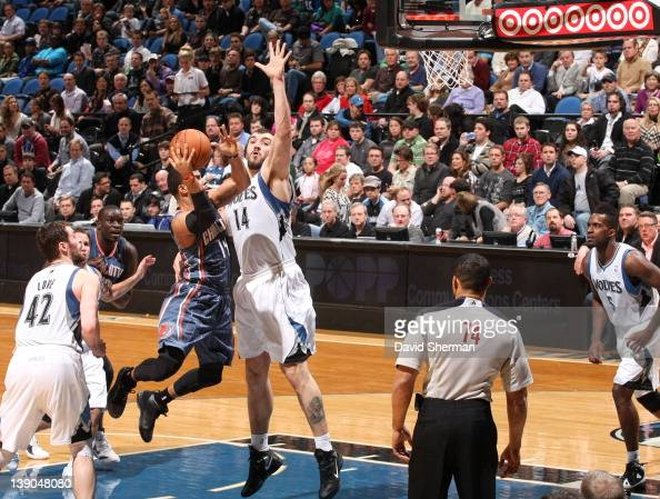 J Augustin of the Charlotte Bobcats goes to the basket against Nikola Pekovic of the Minnesota Timberwolves during the game on February 15 2012 at...