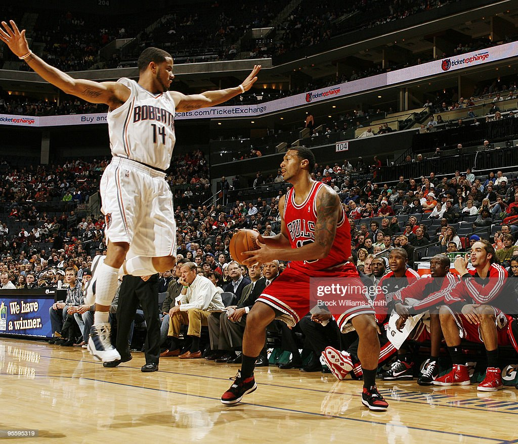 J Augustin of the Charlotte Bobcats guards James Johnson of the Chicago Bulls on January 5 2010 at the Time Warner Cable Arena in Charlotte North...