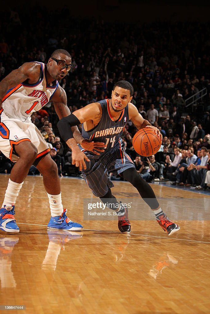 D.J. Augustin #14 of the Charlotte Bobcats moves the ball against Amar'e Stoudemire #1 of the New York Knicks on January 9, 2012 at Madison Square Garden in New York City.