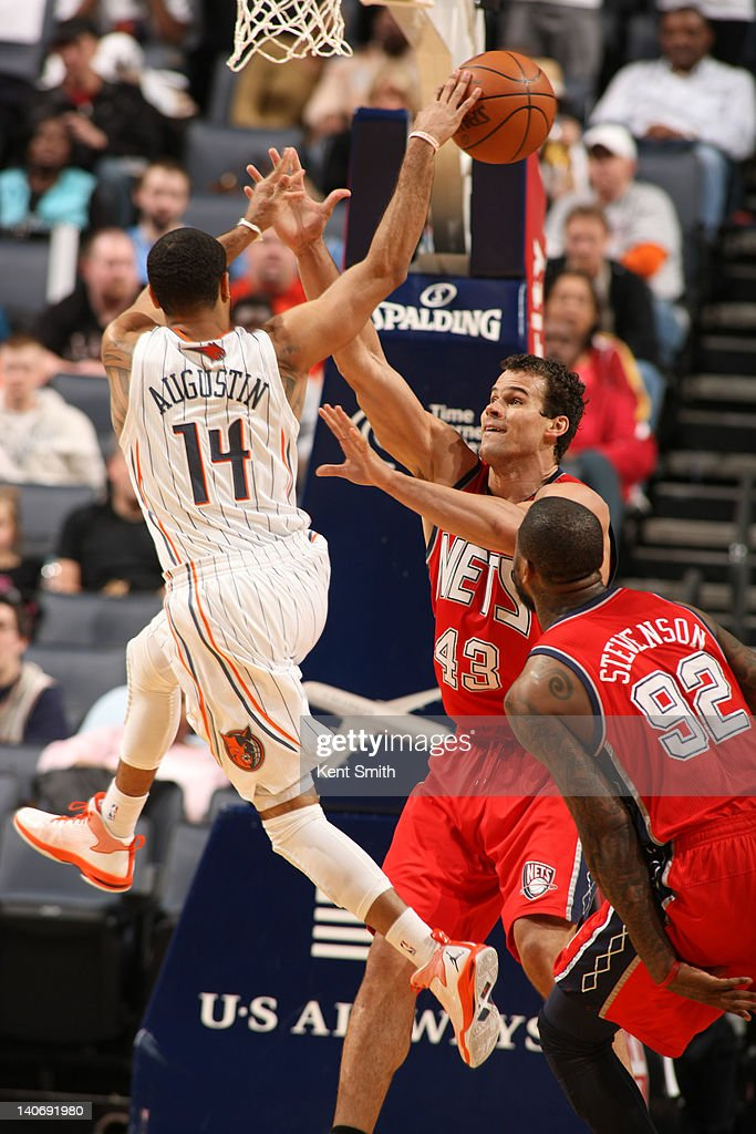 DJ Augustin #14 of the Charlotte Bobcats passes the ball against <a gi-track='captionPersonalityLinkClicked' href=/galleries/search?phrase=Kris+Humphries&family=editorial&specificpeople=209199 ng-click='$event.stopPropagation()'>Kris Humphries</a> #43 of the New Jersey Nets during the game at the Time Warner Cable Arena on March 4, 2012 in Charlotte, North Carolina.