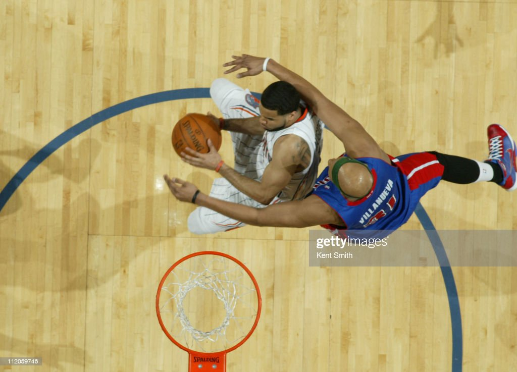 <a gi-track='captionPersonalityLinkClicked' href=/galleries/search?phrase=D.J.+Augustin&family=editorial&specificpeople=3847521 ng-click='$event.stopPropagation()'>D.J. Augustin</a> #14 of the Charlotte Bobcats shoots against <a gi-track='captionPersonalityLinkClicked' href=/galleries/search?phrase=Charlie+Villanueva&family=editorial&specificpeople=215189 ng-click='$event.stopPropagation()'>Charlie Villanueva</a> #31 of the Detroit Pistons on April 10, 2011 at Time Warner Cable Arena on the practice court in Charlotte, North Carolina.