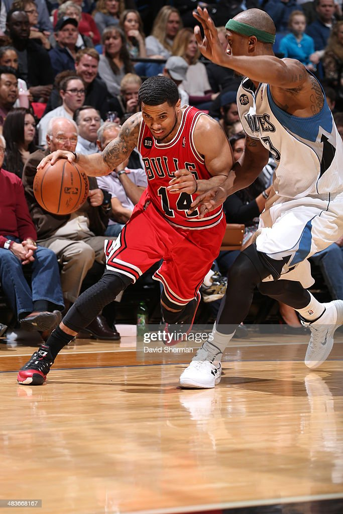 D.J. Augustin #14 of the Chicago Bulls drives baseline against the Minnesota Timberwolves during the game on April 9, 2014 at Target Center in Minneapolis, Minnesota.