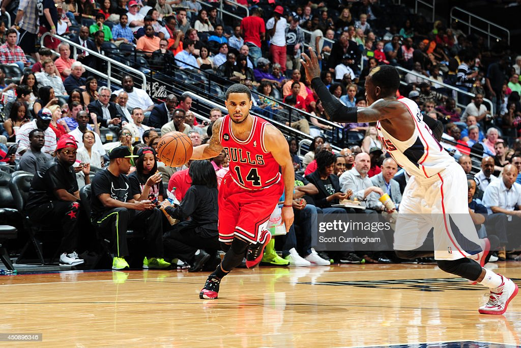 <a gi-track='captionPersonalityLinkClicked' href=/galleries/search?phrase=D.J.+Augustin&family=editorial&specificpeople=3847521 ng-click='$event.stopPropagation()'>D.J. Augustin</a> #14 of the Chicago Bulls drives to the basket against the Atlanta Hawks on April 2, 2014 at Philips Arena in Atlanta, Georgia.