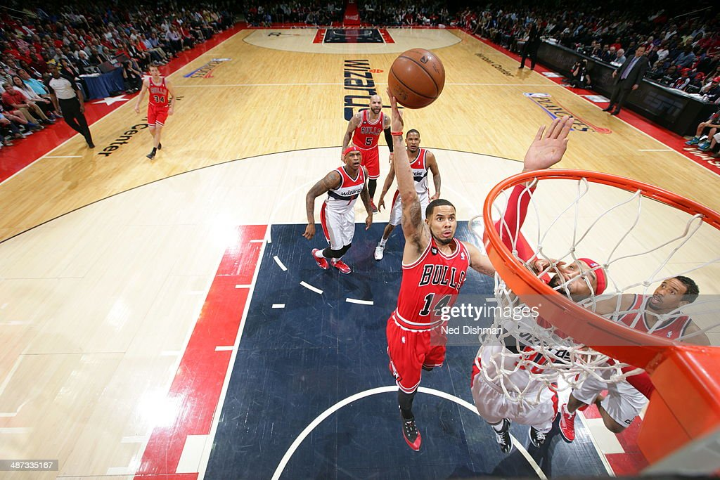 <a gi-track='captionPersonalityLinkClicked' href=/galleries/search?phrase=D.J.+Augustin&family=editorial&specificpeople=3847521 ng-click='$event.stopPropagation()'>D.J. Augustin</a> #14 of the Chicago Bulls drives to the basket against the Washington Wizards in Game Four of the Eastern Conference Quarterfinals during the 2014 NBA Playoffs at the Verizon Center on April 27, 2014 in Washington, DC.