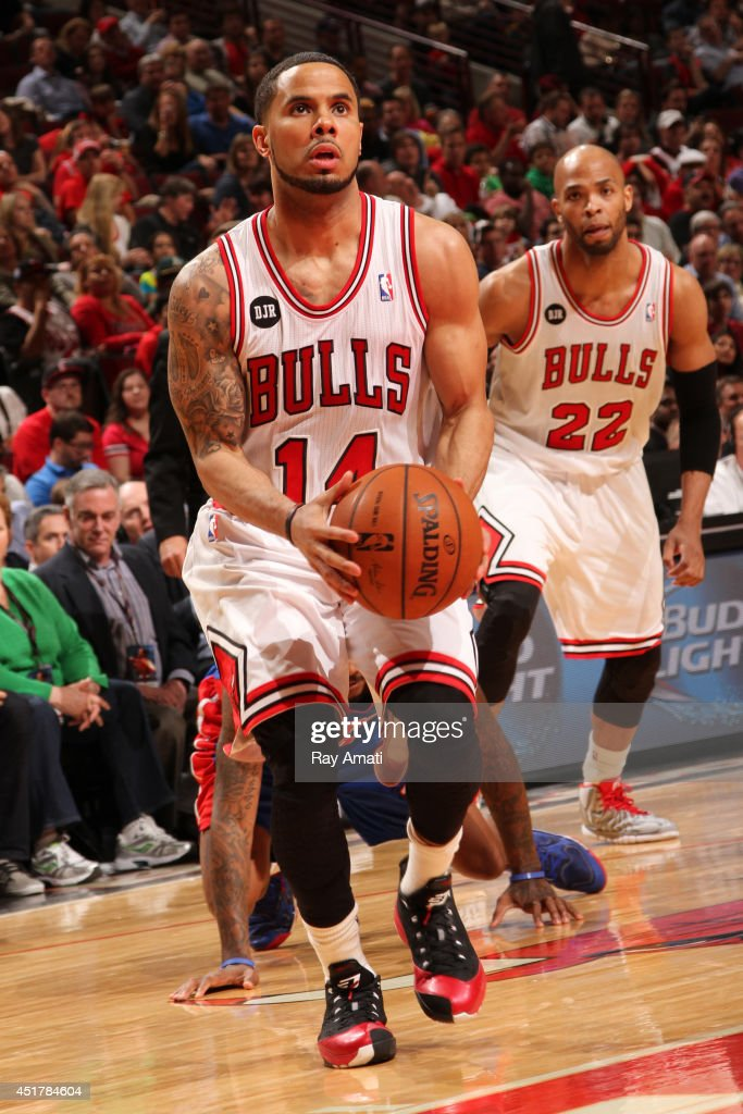 D.J. Augustin #14 of the Chicago Bulls handles the ball against the Detroit Pistons on April 11, 2014 at the United Center in Chicago, Illinois.