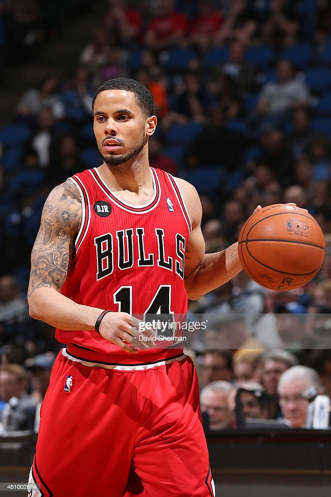 D.J. Augustin #14 of the Chicago Bulls handles the ball against the Minnesota Timberwolves during the game on April 9, 2014 at Target Center in Minneapolis, Minnesota.