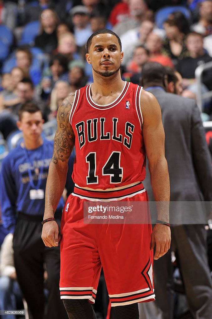 D.J. Augustin #14 of the Chicago Bulls looks on against the Orlando Magic during the game on January 15, 2014 at Amway Center in Orlando, Florida.