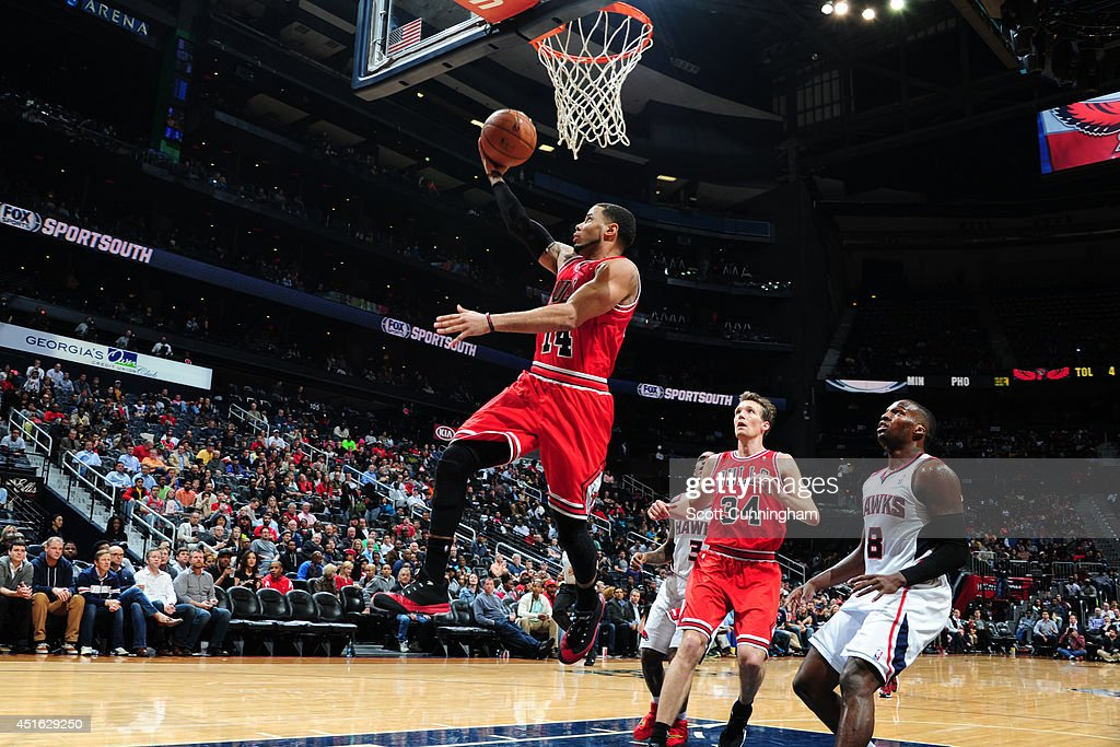 <a gi-track='captionPersonalityLinkClicked' href=/galleries/search?phrase=D.J.+Augustin&family=editorial&specificpeople=3847521 ng-click='$event.stopPropagation()'>D.J. Augustin</a> #14 of the Chicago Bulls shoots against the Atlanta Hawks on February 25, 2014 at Philips Arena in Atlanta, Georgia.