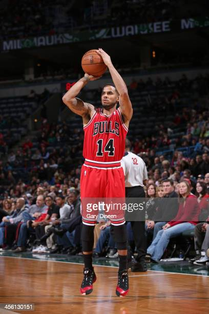 Augustin of the Chicago Bulls shoots against the Milwaukee Bucks on December 13 2013 at the BMO Harris Bradley Center in Milwaukee Wisconsin NOTE TO...