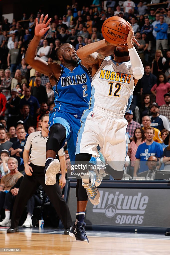 D.J. Augustin #12 of the Denver Nuggets is fouled by Raymond Felton #2 of the Dallas Mavericks with .9 seconds remaining in overtime at Pepsi Center on March 6, 2016 in Denver, Colorado. Augustin made the two free throws for the game winning points as the Nuggets defeated the Mavericks 116-114 in overtime.