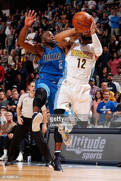 J Augustin of the Denver Nuggets is fouled by Raymond Felton of the Dallas Mavericks with 9 seconds remaining in overtime at Pepsi Center on March 6...