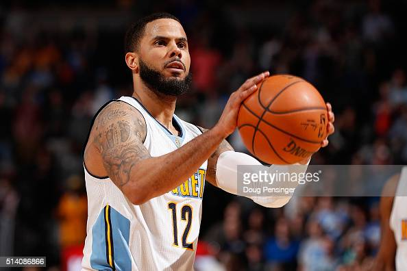 J Augustin of the Denver Nuggets makes the game winning free throws after he was fouled by Raymond Felton of the Dallas Mavericks with 9 seconds...