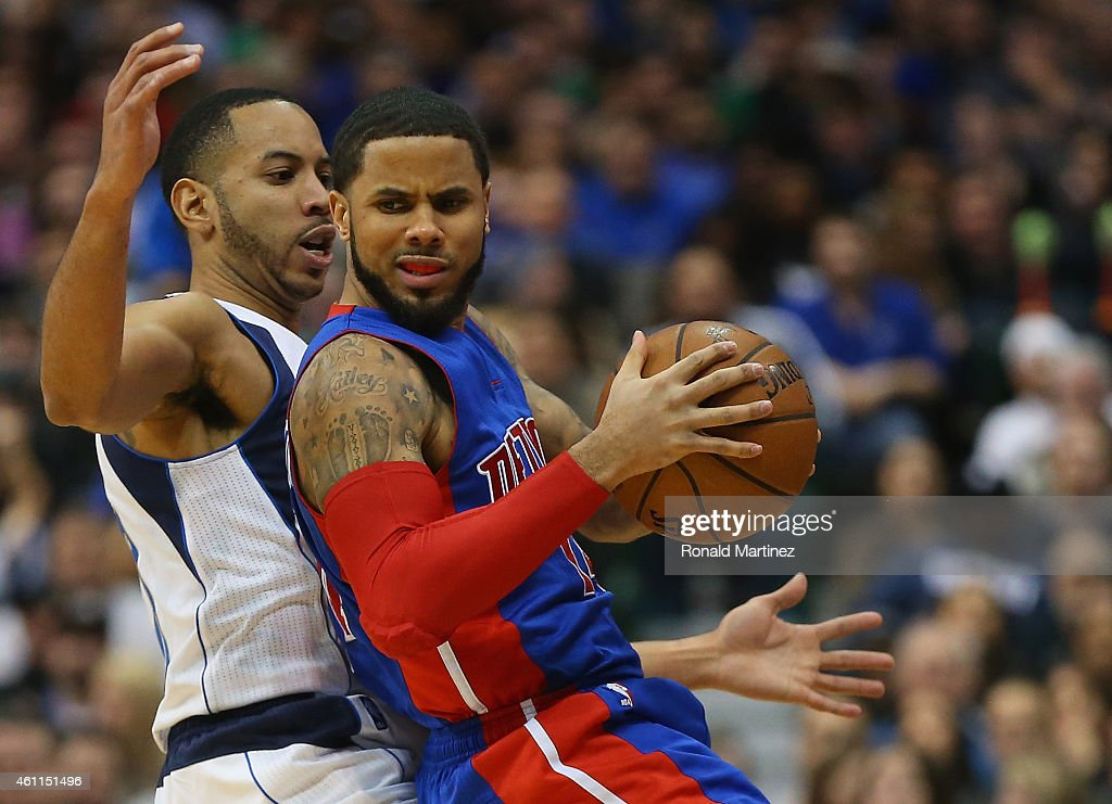 J Augustin of the Detroit Pistons dribbles the ball against Devin Harris of the Dallas Mavericks at American Airlines Center on January 7 2015 in...