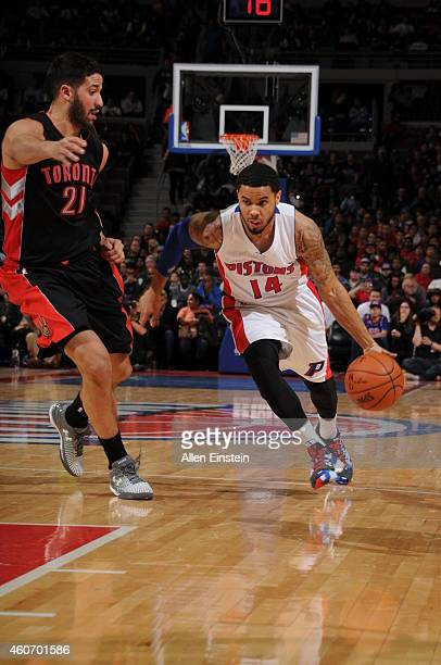 J Augustin of the Detroit Pistons drives to the basket against Greivis Vasquez of the Toronto Raptors on December 19 2014 at the Palace of Auburn...