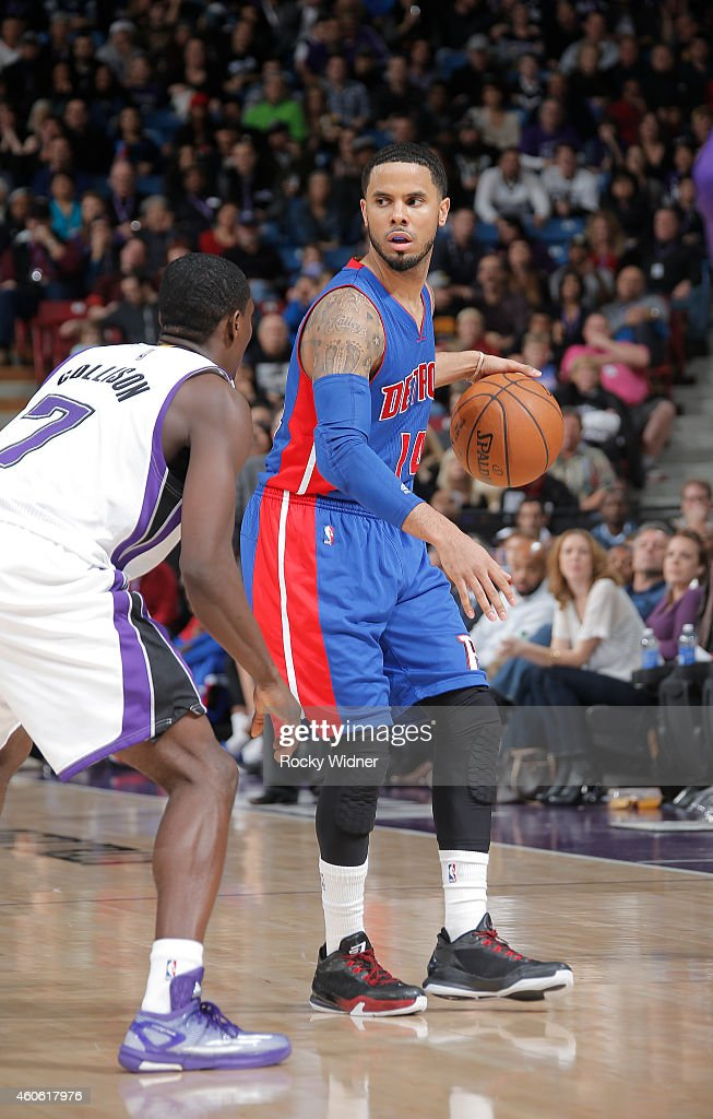 J Augustin of the Detroit Pistons handles the ball against Darren Collison of the Sacramento Kings on December 13 2014 at Sleep Train Arena in...