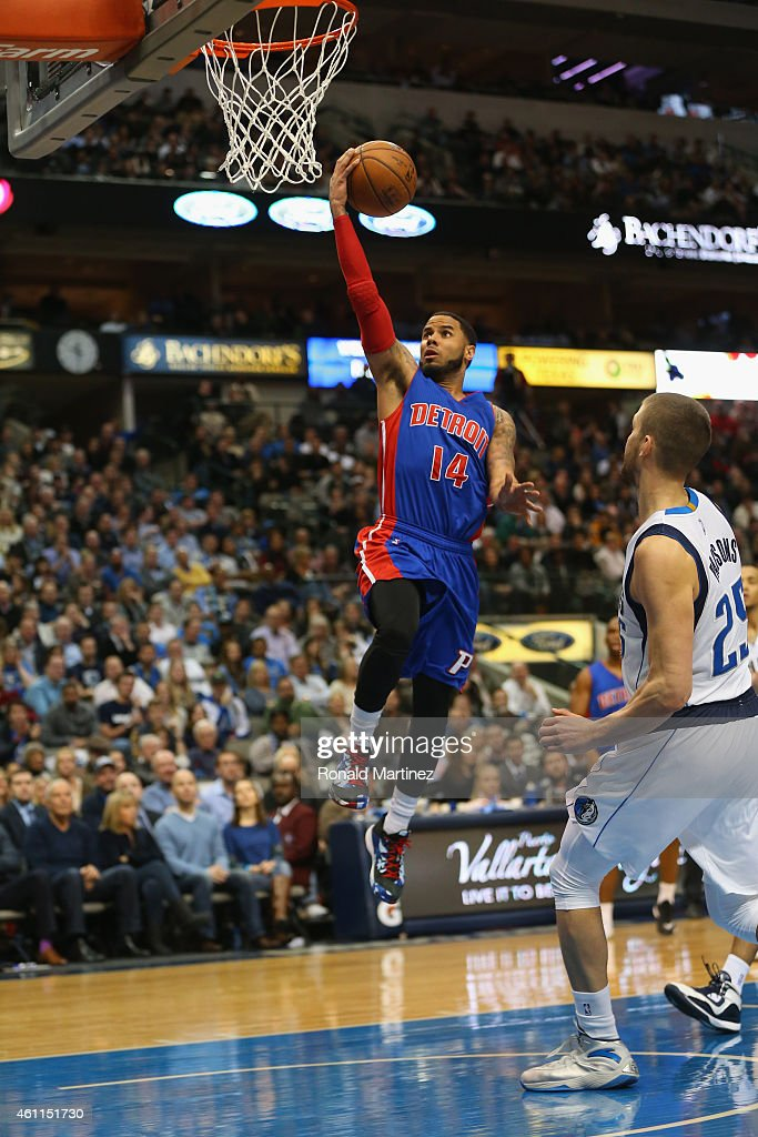 J Augustin of the Detroit Pistons makes a layup against Chandler Parsons of the Dallas Mavericks at American Airlines Center on January 7 2015 in...