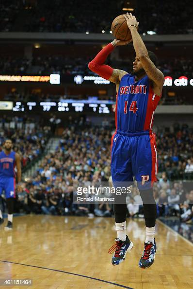J Augustin of the Detroit Pistons makes a threepoint shot against the Dallas Mavericks at American Airlines Center on January 7 2015 in Dallas Texas...