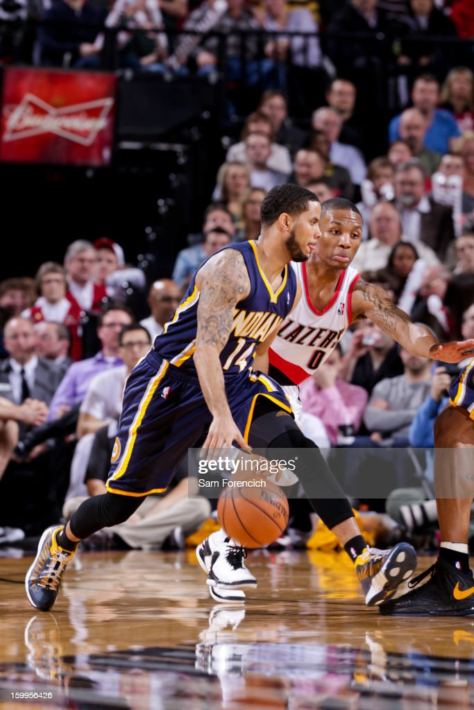 D.J. Augustin #14 of the Indiana Pacers dribbles the ball between his legs against Damian Lillard #0 of the Portland Trail Blazers on January 23, 2013 at the Rose Garden Arena in Portland, Oregon.