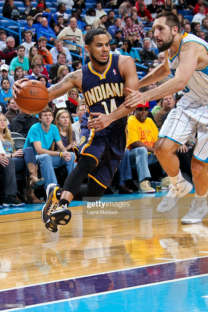 <a gi-track='captionPersonalityLinkClicked' href=/galleries/search?phrase=D.J.+Augustin&family=editorial&specificpeople=3847521 ng-click='$event.stopPropagation()'>D.J. Augustin</a> #14 of the Indiana Pacers drives against Ryan Anderson #33 of the New Orleans Hornets on December 22, 2012 at the New Orleans Arena in New Orleans, Louisiana.