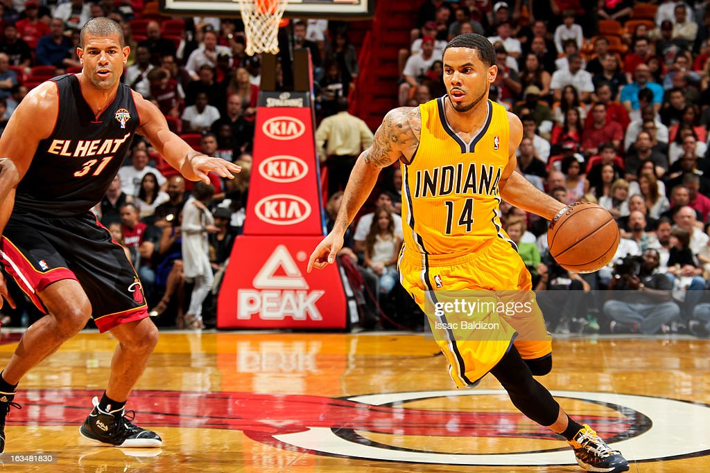 D.J. Augustin #14 of the Indiana Pacers drives against Shane Battier #31 of the Miami Heat on March 10, 2013 at American Airlines Arena in Miami, Florida.