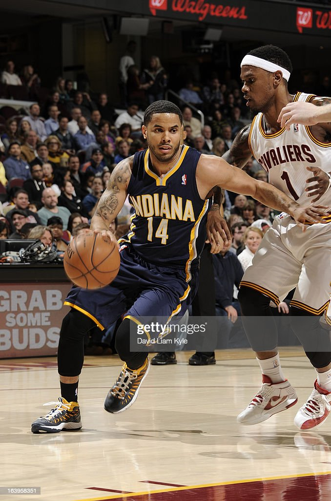 D.J. Augustin #14 of the Indiana Pacers drives to the basket against Daniel Gibson #1 of the Cleveland Cavaliers at The Quicken Loans Arena on March 18, 2013 in Cleveland, Ohio.