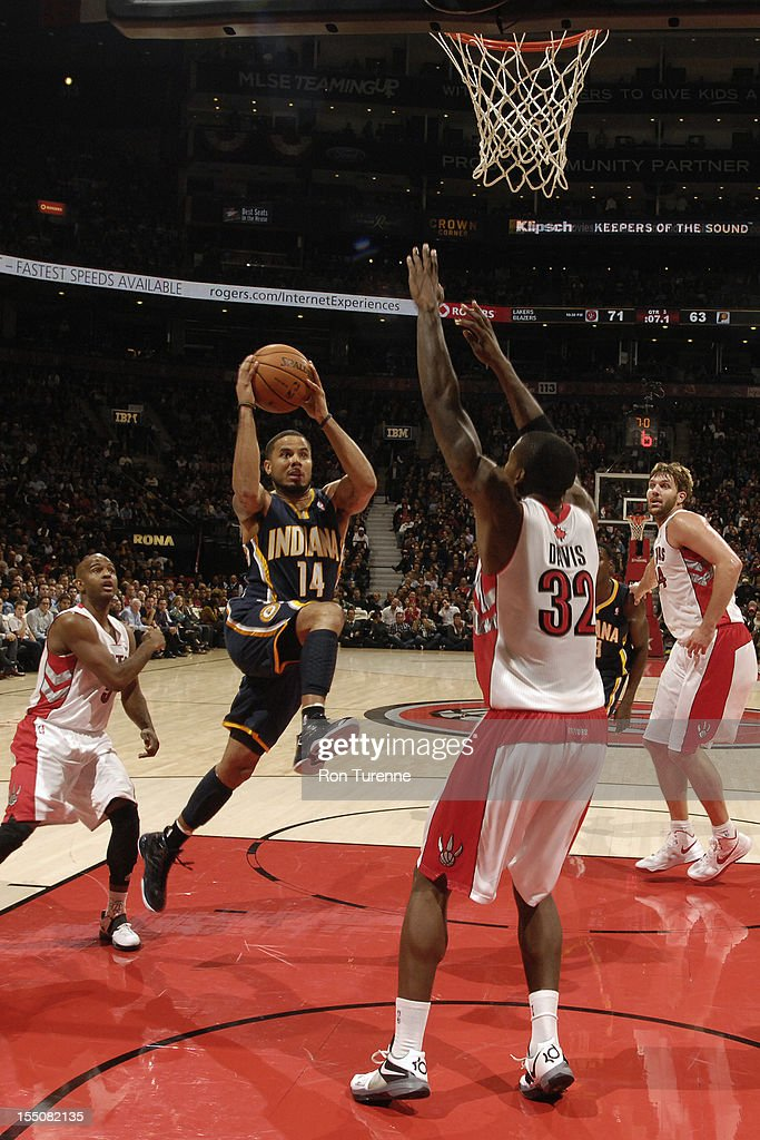 <a gi-track='captionPersonalityLinkClicked' href=/galleries/search?phrase=D.J.+Augustin&family=editorial&specificpeople=3847521 ng-click='$event.stopPropagation()'>D.J. Augustin</a> #14 of the Indiana Pacers drives to the basket against Ed Davis #32 of the Toronto Raptors on October 31, 2012 at the Air Canada Centre in Toronto, Ontario, Canada.