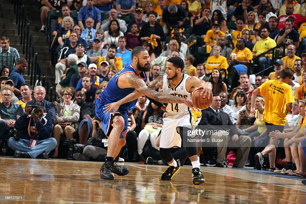 D.J. Augustin #14 of the Indiana Pacers drives to the basket against the New York Knicks in Game Four of the Eastern Conference Semifinals during the 2013 NBA Playoffs on May 14, 2013 at Bankers Life Fieldhouse in Indianapolis.