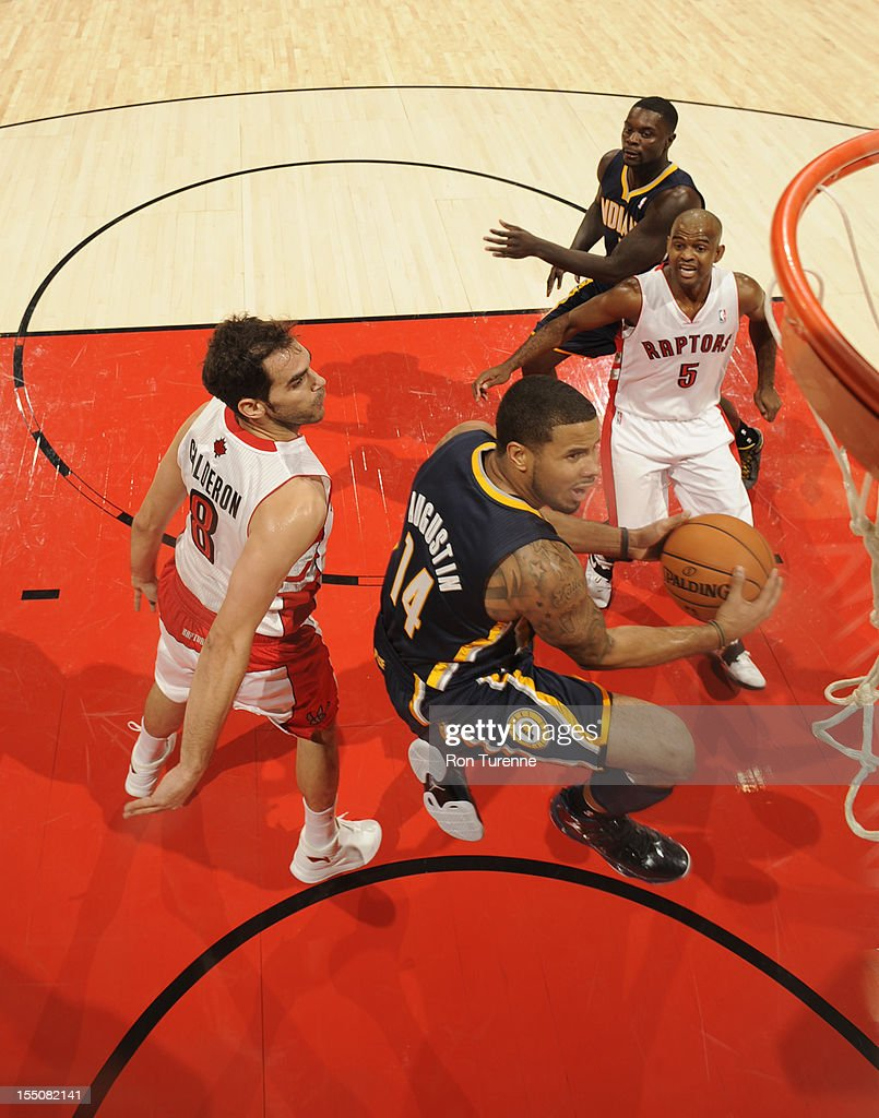 D.J. Augustin #14 of the Indiana Pacers drives to the basket against the Toronto Raptors on October 31, 2012 at the Air Canada Centre in Toronto, Ontario, Canada.