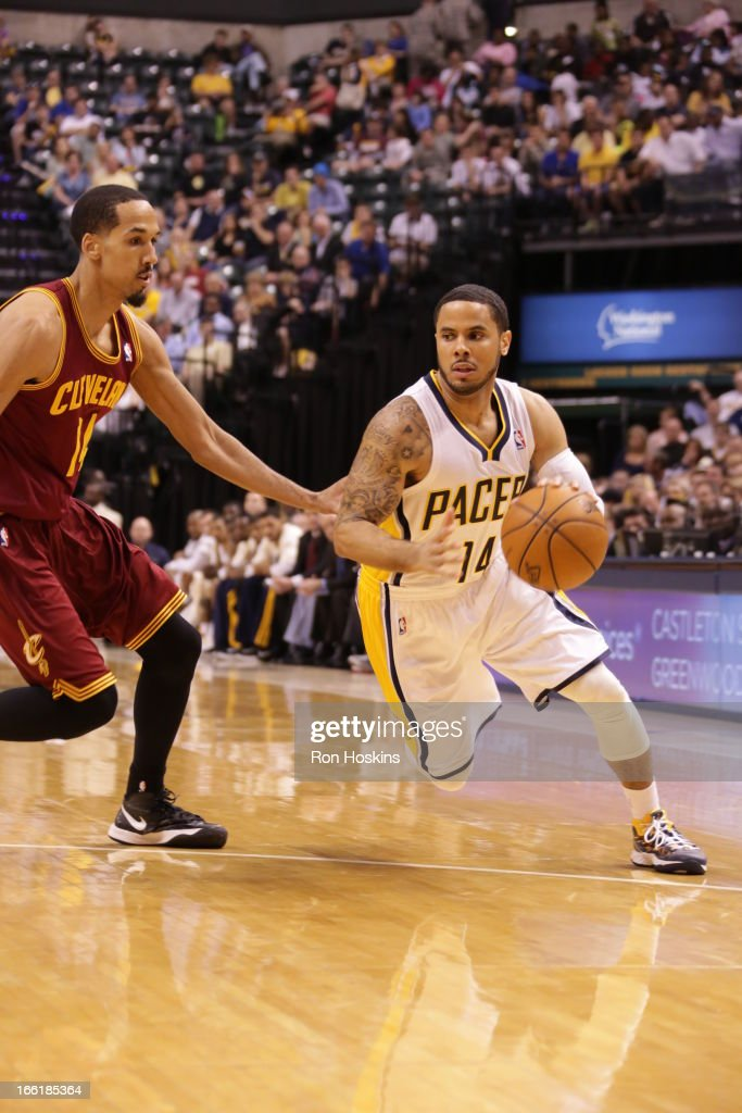 <a gi-track='captionPersonalityLinkClicked' href=/galleries/search?phrase=D.J.+Augustin&family=editorial&specificpeople=3847521 ng-click='$event.stopPropagation()'>D.J. Augustin</a> #14 of the Indiana Pacers drives to the hoop against <a gi-track='captionPersonalityLinkClicked' href=/galleries/search?phrase=Shaun+Livingston&family=editorial&specificpeople=202955 ng-click='$event.stopPropagation()'>Shaun Livingston</a> #14 of the Cleveland Cavaliers on April 8, 2013 at Bankers Life Fieldhouse in Indianapolis, Indiana.
