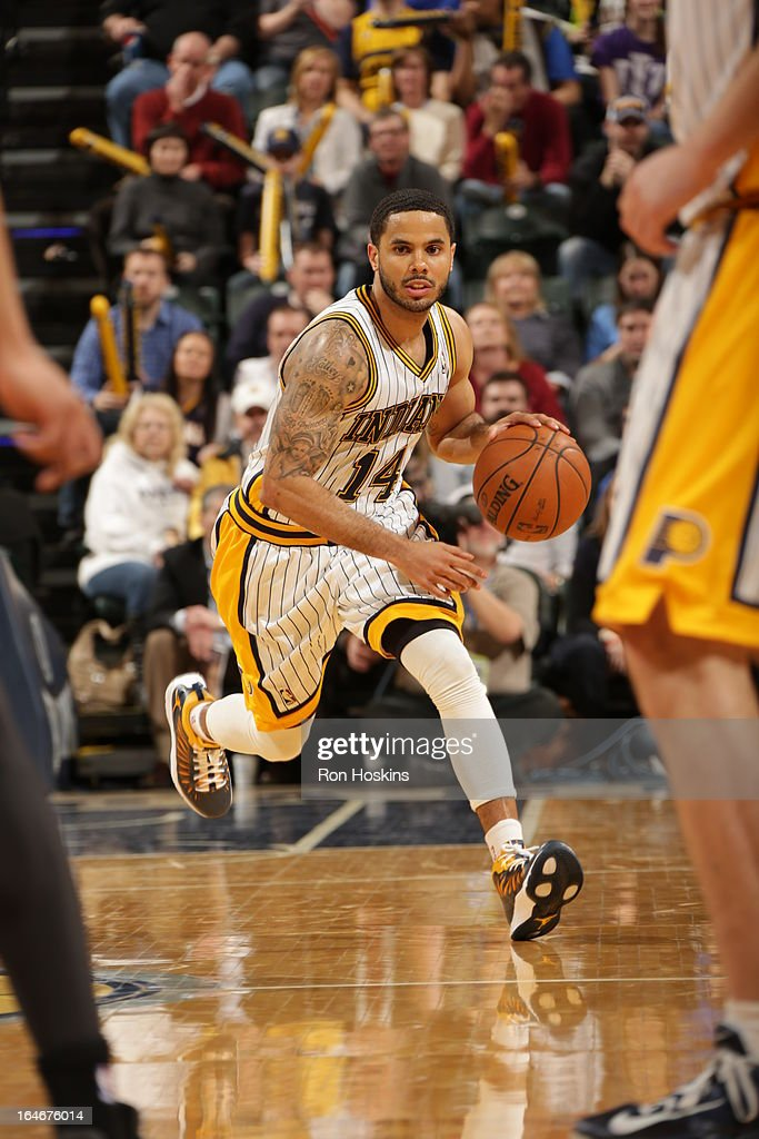 D.J. Augustin #14 of the Indiana Pacers drives up-court against the Atlanta Hawks on March 25, 2013 at Bankers Life Fieldhouse in Indianapolis, Indiana.