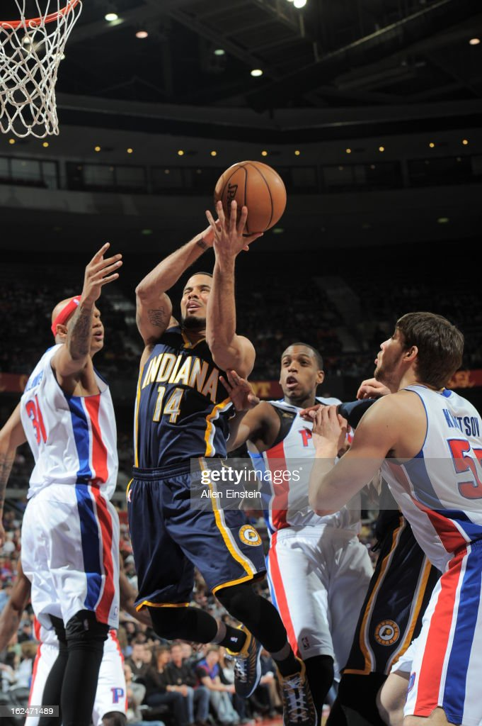 J Augustin of the Indiana Pacers goes to the basket agaionst Charlie Villanueva Khris Middleton and Viacheslav Kravtsov of the Detroit Pistons on...