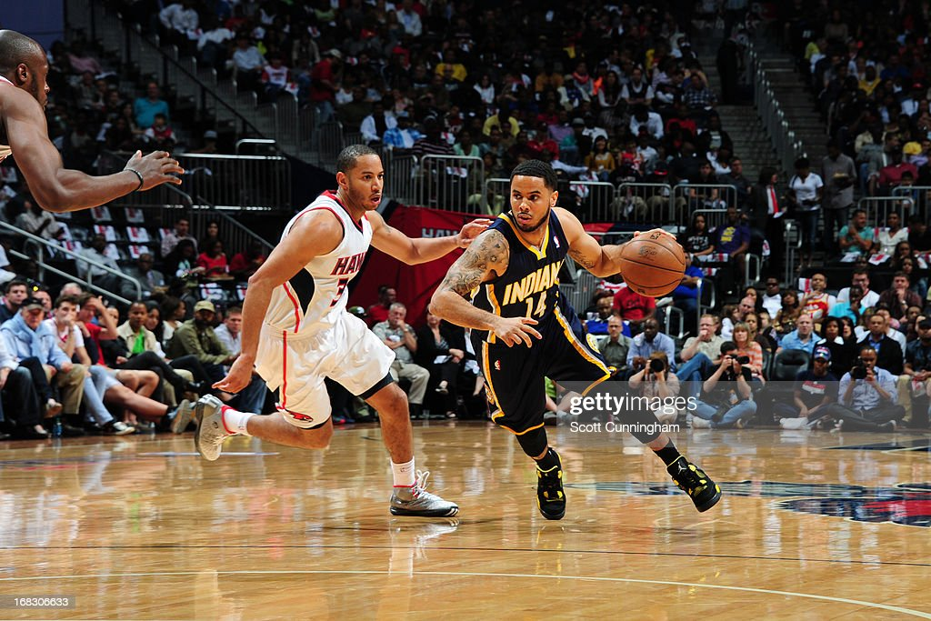 D.J. Augustin #14 of the Indiana Pacers handles the ball against Devin Harris #34 of the Atlanta Hawks in Game Three of the Eastern Conference Quarterfinals in the 2013 NBA Playoffs on April 27, 2013 at Philips Arena in Atlanta, Georgia.
