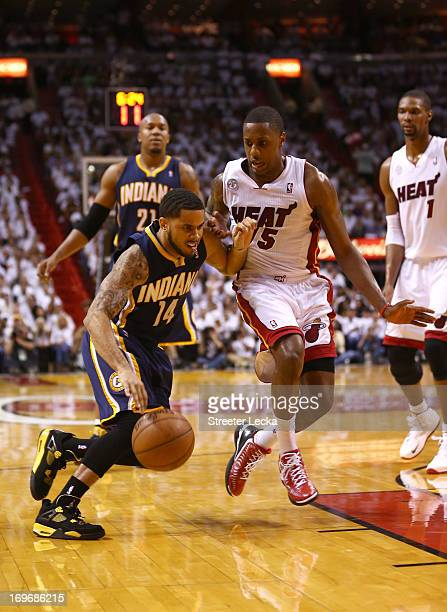 J Augustin of the Indiana Pacers handles the ball against Mario Chalmers of the Miami Heat in the third quarter during Game Five of the Eastern...