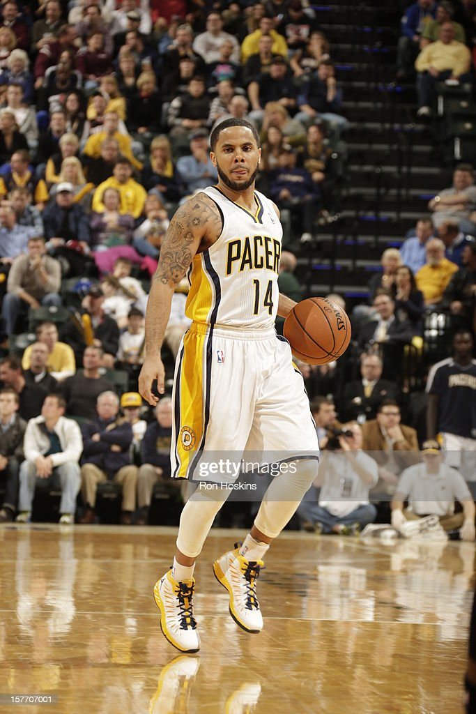 <a gi-track='captionPersonalityLinkClicked' href=/galleries/search?phrase=D.J.+Augustin&family=editorial&specificpeople=3847521 ng-click='$event.stopPropagation()'>D.J. Augustin</a> #14 of the Indiana Pacers handles the ball against the Portland Trail Blazers on December 5, 2012 at Bankers Life Fieldhouse in Indianapolis, Indiana.