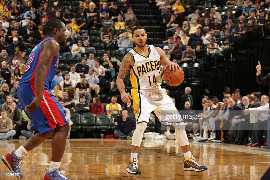D.J. Augustin #14 of the Indiana Pacers handles the ball against Will Bynum #12 of the Detroit Pistons on January 30, 2013 at Bankers Life Fieldhouse in Indianapolis, Indiana.